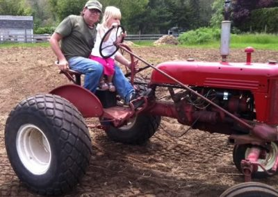 Flotation-Tires-Rims-Guy-Girl-on-Tractor